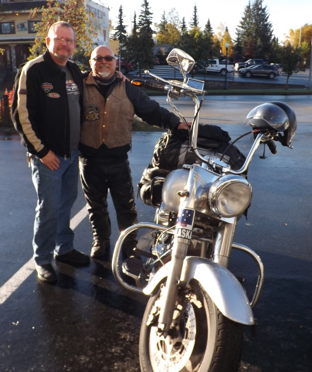 Angelo Gaboardi (left)  poses with our service manager Steve Webb (right) and His 1990 Fat Boy