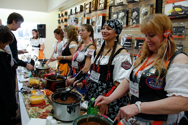 2012 Contestants serving chili during the chili cook-off
